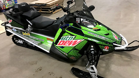 Mountain Dew and Outdoor Bound TV themed Polaris snowmobile