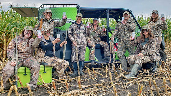 The Outdoor Bound Goose Hunting Team posting in camoflauge with rifles and Bubbl'r beverages with the Mountain Dew UTV